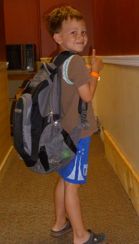 He's got his backpack, his waterbottle, his swimsuit and he's ready to go!!
