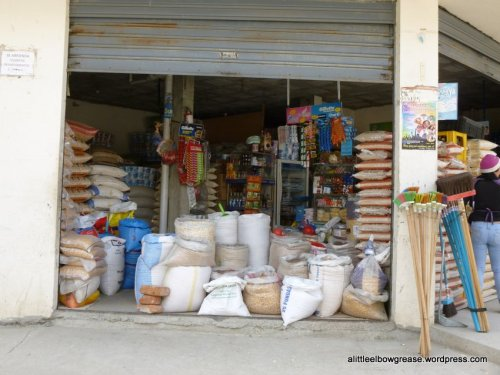 Sort of a general store selling pretty much all you could want out of those bags..rice, corn, noodles, dogfood...